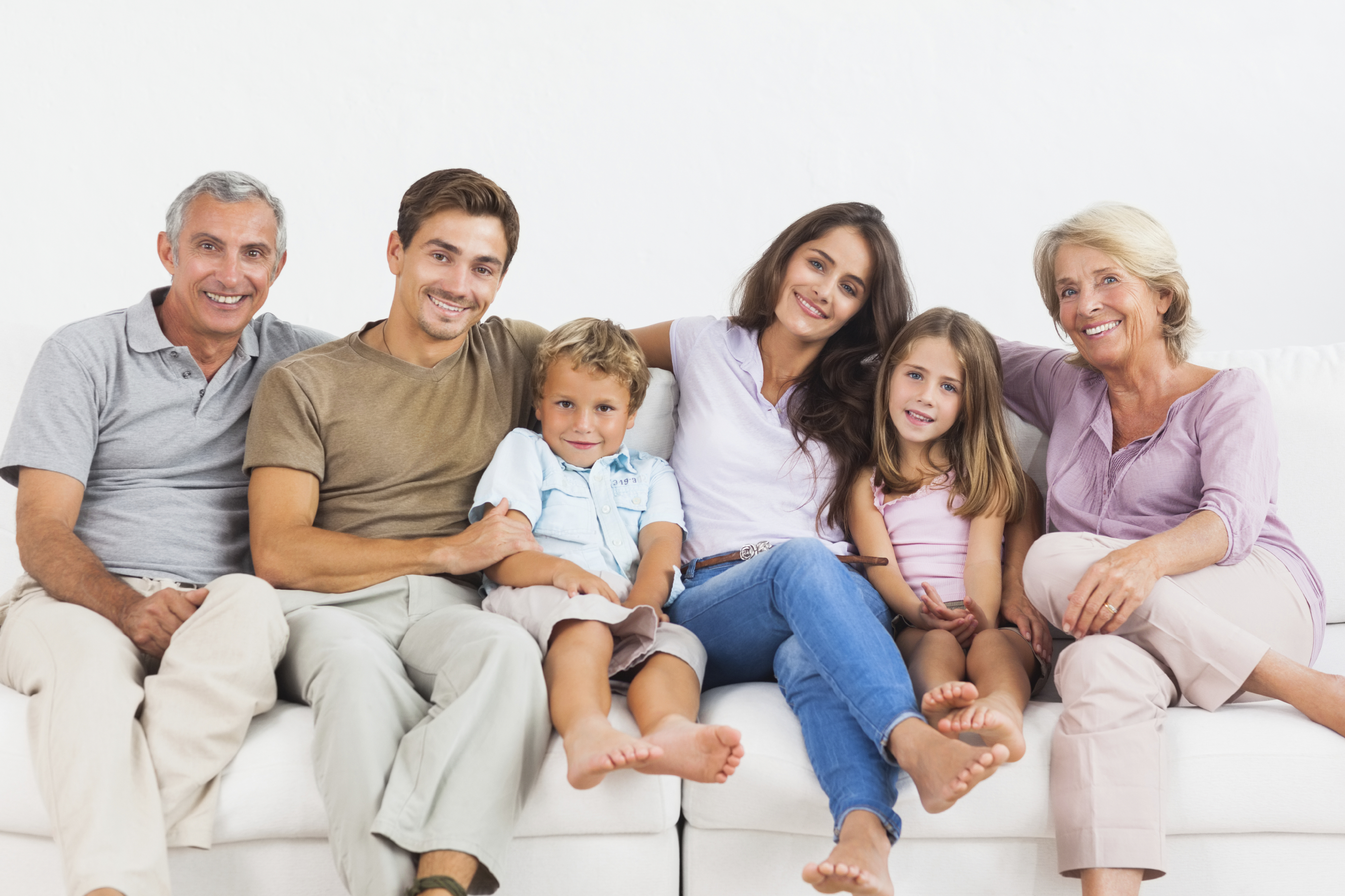 Extended family sitting on a sofa